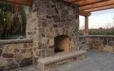 rustic backyard fireplace